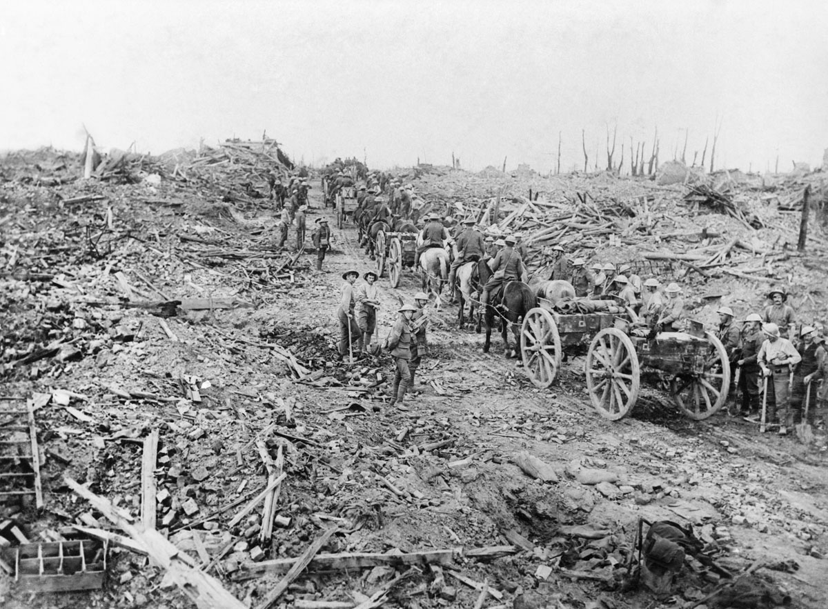 Ammunition limbers, drawn by horses, pass through the ruined village of Longueval, September 1916.