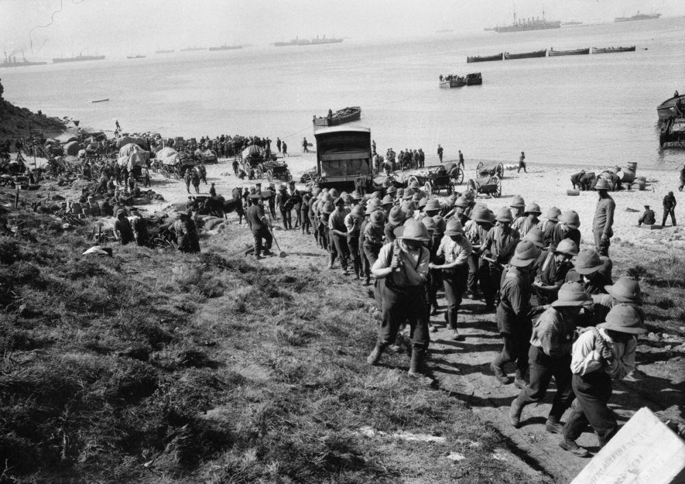 British troops hauling an ambulance wagon off W Beach.