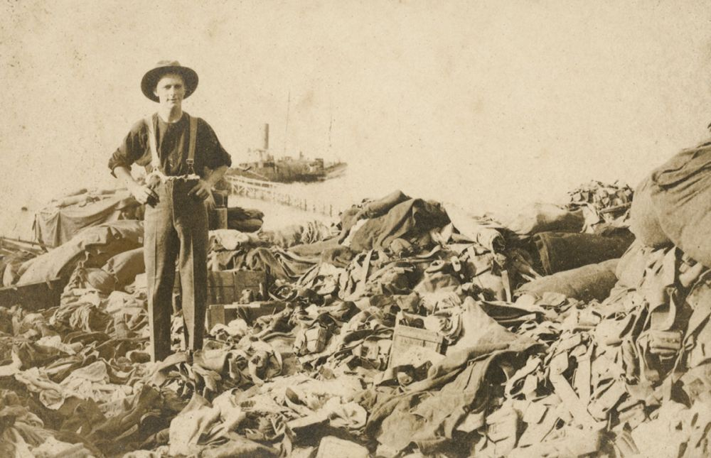 A soldier standing at the supply dump at North Beach, prior to the fire on the 18 December 1915.