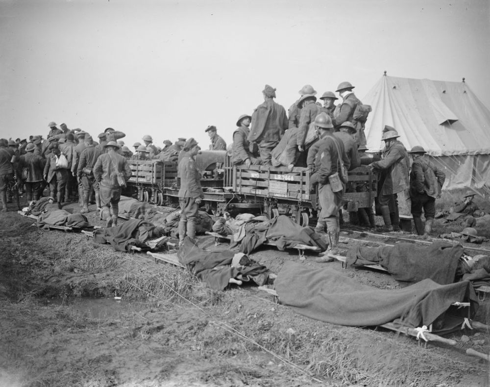 British and Belgian wounded waiting to be evacuated by light rail during the Battle of Courtrai, Dadezeele, 15 October 1918.