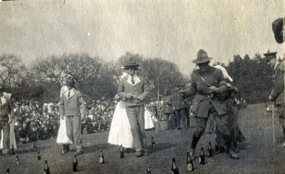 Blindfolded New Zealand soldiers (some patients in hospital uniforms) play a game, guided by nurses, at Anzac Day sports, Brockenhurst.