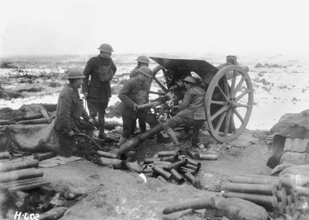 New Zealand artillerymen firing their gun in the Butte, Belgium. 1 January 1918.