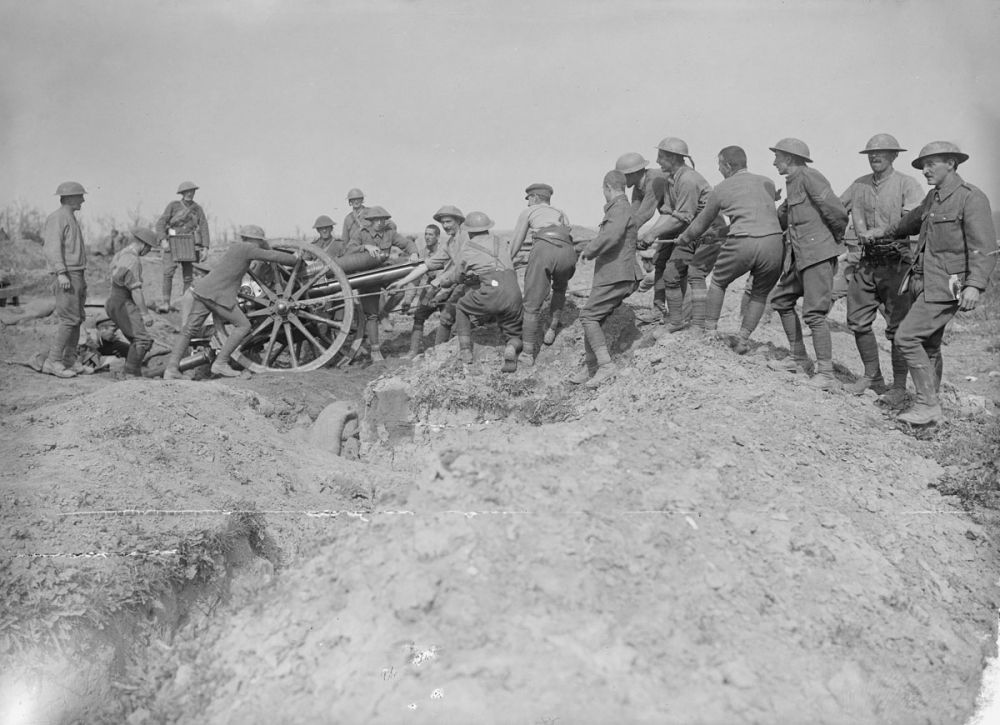 A Royal Field Artillery gun crew haul an 18-pounder into position near Delville Wood, 15 September 1916.