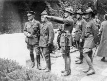 Leslie Averill (pointing) at the dedication ceremony for the New Zealand memorial at Le Quesnoy, France, 1923.