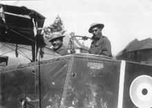 Members of the Maori Pioneer Battalion pose inside an aeroplane.
