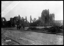 Soldiers walk among the ruins in the town of Ypres, Belgium, 1917.