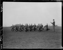 New Zealand soldiers from the Canterbury Battalion exercising under direction from their instructor. Sling Camp, Bulford, England.