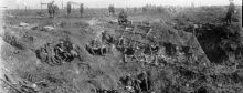 New Zealand Engineers resting in a large shell crater at Spree Farm, Ypres Salient, 12 October 1917.