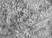 Aerial view, somewhere over the Ypres Salient, showing the pock-marked earth, riddled with shell craters, and the remains of several trenches.