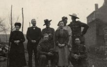 "A group of unidentified Australian and New Zealand soldiers with French civilians ""somewhere in France""."