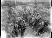 Men of the Maori Pioneer Battalion take a break in a trench near Gommecourt. 25 July 1918.