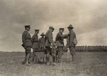 General Russell awards a soldier a medal  for gallantry - earned in the fighting at Meteren, France 1918.
