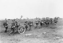 German soldiers haul a granatenwerfer - a type of grenade or mortar thrower - forward in support of advancing stormtroops, 15 July 1918.